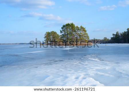 Frozen lake landscape in spring - stock photo