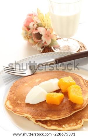 frozen mango and pan cake with yogurt sauce - stock photo
