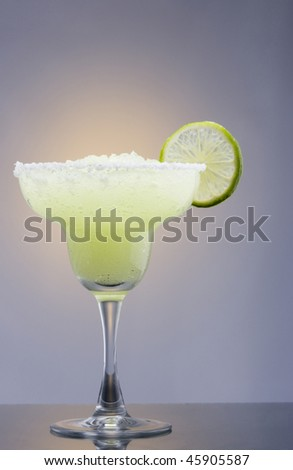 Frozen Margarita mixed drink with lime slice on plain background close up - stock photo