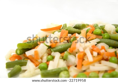 Frozen mixed vegetables in isolated white background