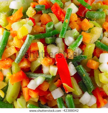 Frozen mixed vegetables with ice - stock photo