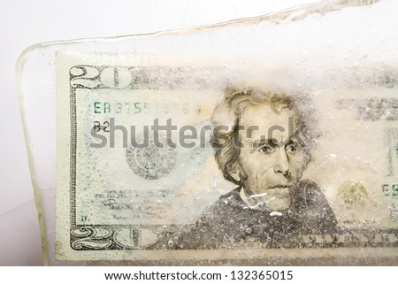frozen money twenty dollars portrait of the president sharply - stock photo