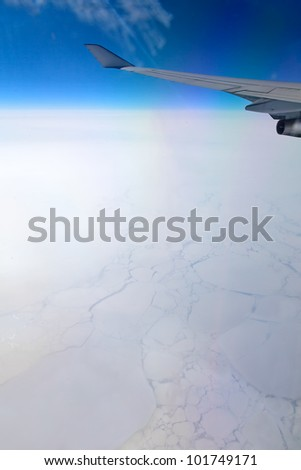 Frozen ocean, aerial view from illuminator of flying aircraft - stock photo