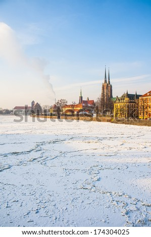 Frozen Odra river with old city in the background. Wroclaw, Poland - stock photo