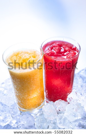Frozen orange and raspberry smoothie with icecubes - stock photo