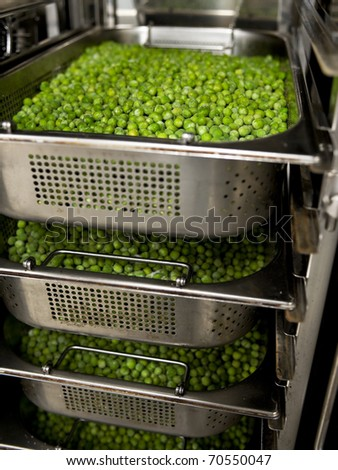 frozen peas in the steamer - stock photo