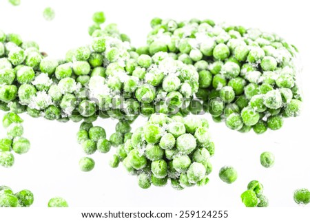 Frozen peas on the white background - stock photo