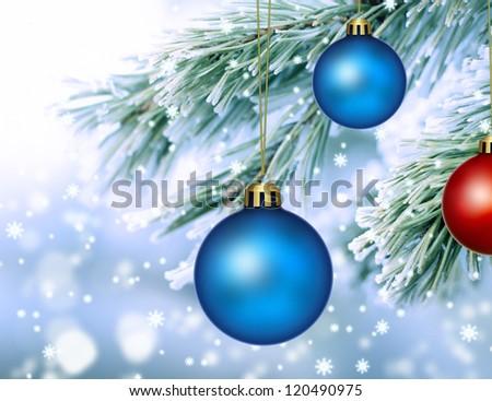 frozen pine fir with Christmas balls - stock photo