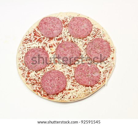 frozen pizza with salami and cheese isolated on white background - stock photo