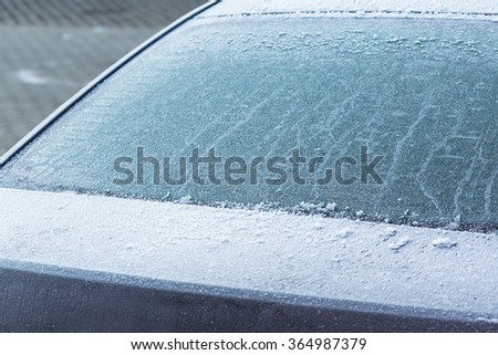 Frozen rear windshield in the car at winter - stock photo