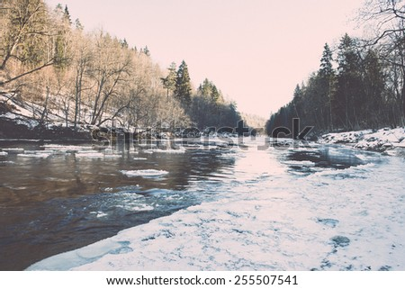 frozen river in winter with sandstone cliffs and ice blocks. Gauja National Park. Latvia. -vintage retro effect