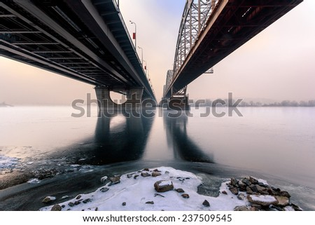 Frozen river. Two parallel bridges. Kiev. Ukraine. - stock photo