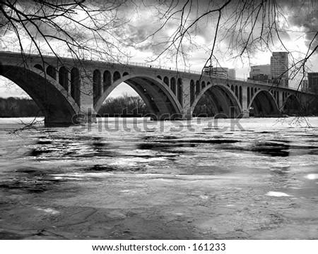 Frozen River - Washington, DC: Key Bridge over a frozen Potomac River - stock photo