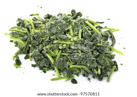frozen spinach on white - stock photo