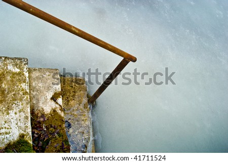 Frozen steps of a pier - stock photo