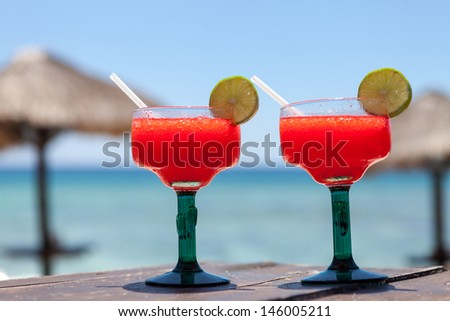 Frozen strawberry margaritas on the beach in Mexico. Summer beach background. - stock photo