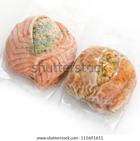 Frozen Stuffed Salmon And Tilapia Fillets In A Vacuum Package - stock photo