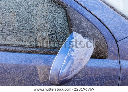 Frozen surface of the car during winter mornings - stock photo
