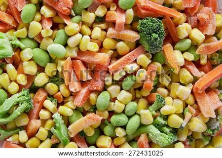 Frozen vegetables. Frozen vegetable mixture of carrots, corn and peas. - stock photo