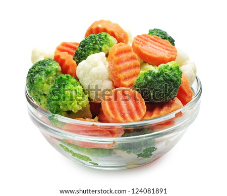 Frozen vegetables in a glass bowl on a white background - stock photo