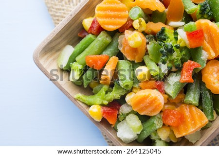 Frozen vegetables  in a wooden table.