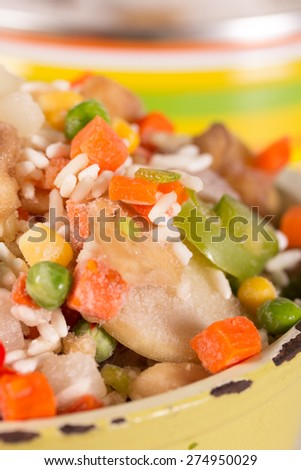 Frozen vegetables in an old enamel saucepan  before cooking