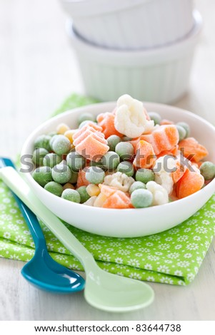 frozen vegetables in bowl with spoon - stock photo