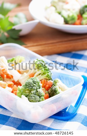 frozen vegetables in plastic box - stock photo