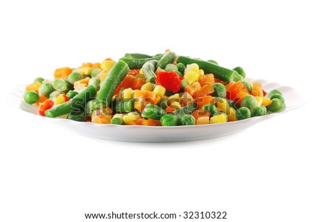 Frozen vegetables in white plate - stock photo