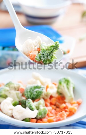 frozen vegetables on white spoon - stock photo