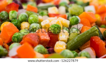Frozen vegetables with ice - stock photo