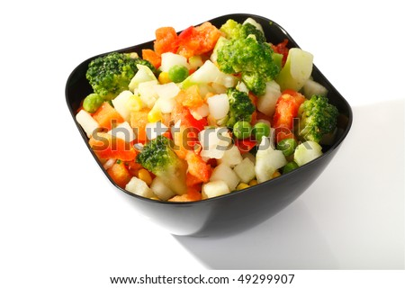Frozen vegetables with ice crystals and frost in the steel cup on a white background - stock photo