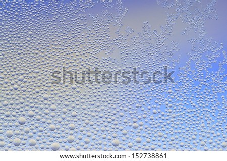 Frozen water drop in the window - stock photo