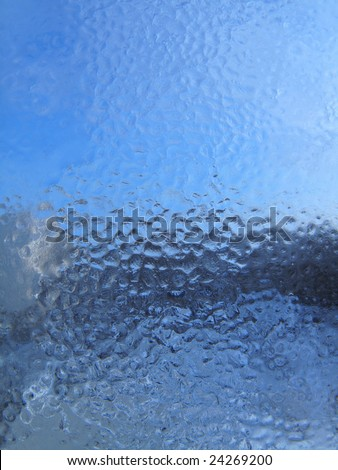 Frozen water drops on glass background - stock photo