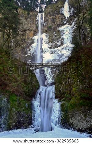Frozen Waterfall and Bridge. Multnomah Falls, Columbia River Gorge, Oregon. - stock photo