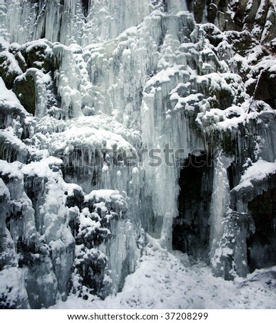 Frozen waterfall with icicles - seen at park Wilhelmshöhe in Kassel, Germany - stock photo