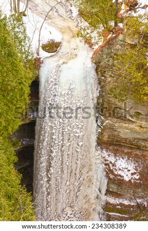 Frozen Wildcat Falls in Starved Rock State Park in Illinois in the Winter - stock photo