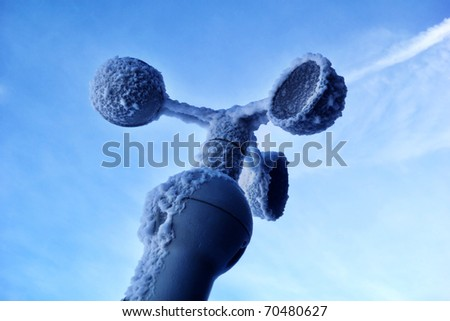 Frozen wind meter device - extreme mountain condition view - stock photo