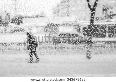 frozen window with ice background with silhouette of man. Person behind the glass - stock photo