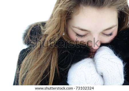 Frozen woman heated by mittens and a fur from hood - stock photo