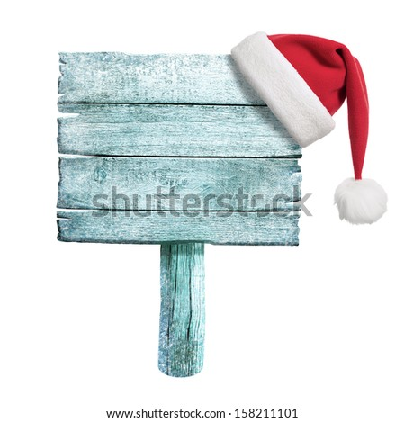 frozen wooden sign with red Santa's hat