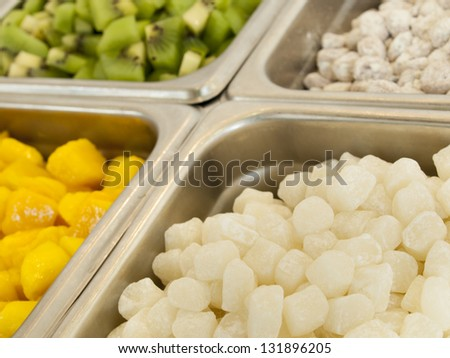 Frozen yogurt toppings bar. Yogurt toppings ranging from fresh fruits ...