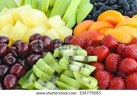 Fruit and berry mix: pineapple, kiwi, cherry, apple, strawberry, mulberry, apricot, peach - stock photo