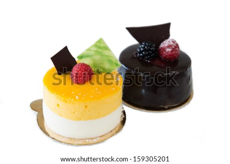 fruit and chocolate cake decorated with fruit on a white background - stock photo