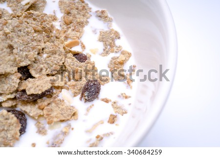 Fruit and grain flake on white background - stock photo