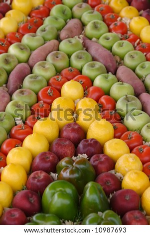 Fruit and veg on display in a market - stock photo