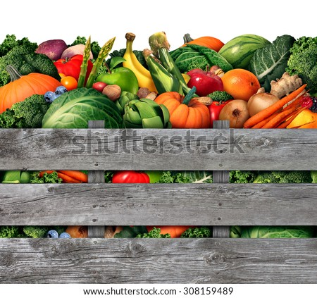 Fruit and vegetable harvest from a farmers market with a group of assorted natural raw fruits and vegetables as healthy organic food in a rustic wood box. - stock photo