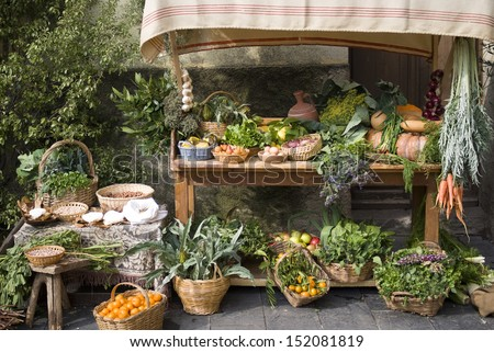 Fruit and vegetable stall at a medieval market - stock photo