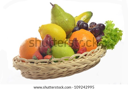 Fruit and vegetables . A basket of various fresh and healthy fruit isolated in  white