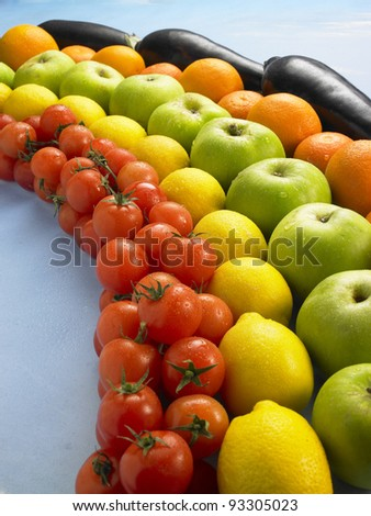 fruit and vegetables arranged as a rainbow - stock photo
